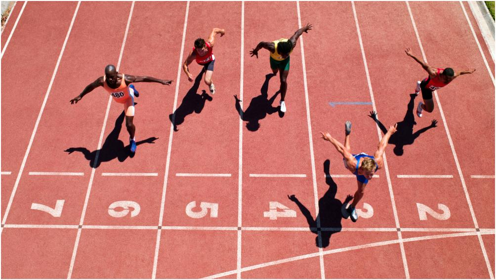 Four runners cross finish line from above