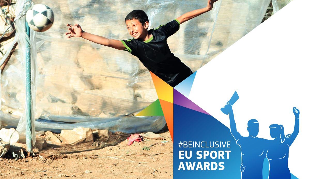 child diving for football; beinclusive logo in corner