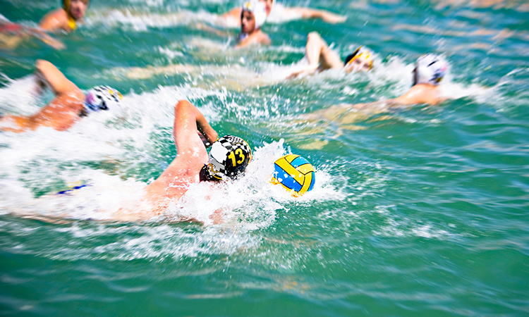Swimmer in blue water
