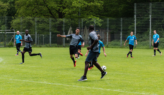 The team of TSV Scharnhausen playing a friendly match of soccer against a team of refugees (GERMANY - MAY 14, 2016)